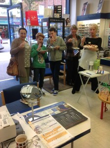 Customers enjoy some cake at Scher & Lasky Opticians